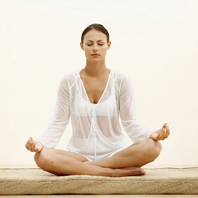 Front view of a relaxed woman meditating